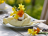 Daffodils Easter table decoration on the terrace