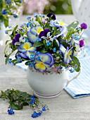 Small bouquet in cup viola 'Etain', viola cornuta