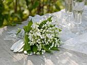 Bridal bouquet of Convallaria majalis, white lace ribbon