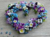 Heart on spring flowers
