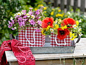 Meadow flowers in red and white checkered gift bags