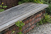 Selfmade Gabion bench with old clay pots
