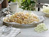 In pancake batter fried elderflower