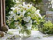 White bouquet of Leucanthemum vulgare, Campanula
