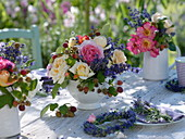 Summer table decoration with roses, lavender and raspberries