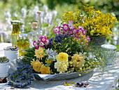 Freshly picked medicinal herbs on metal tray
