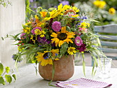 Colorful cottage garden bouquet with Helianthus, Callistephus