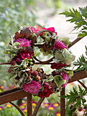 Autumn wreath on the fence from Callistephus, Hydrangea