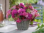 Pink (rose) and Viburnum lantana fruit stalks arrangement