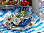 Bavarian table decoration, wooden board with blue napkin