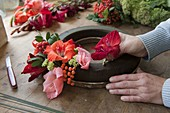 Late summer wreath of gladioli, rowan berries and fat hen
