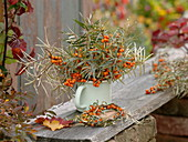 Bouquet and wreath of Hippophae rhamnoides in the enamel pot
