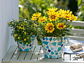Gluing clay pots with turquoise mosaic