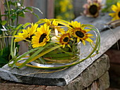 Lantern with sunflowers and grasses
