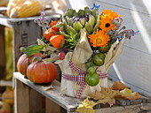 Thanksgiving - arrangement stuck in yoghurt pail with corn leaves