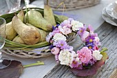 Autumn table decoration with asters and pears