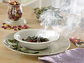 Burning incense with home-dried herbs such as sage and roses