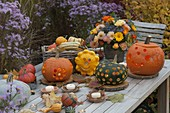 Autumnal arrangement with pumpkins on wooden table