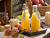 Bottles of freshly squeezed apple juice, jars of jelly and applesauce
