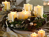 Fast Advent wreath with star candles, cones, Abies branches