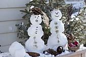 Mini snowmen with nature decoration