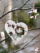 Stars and hearts with frozen berries, leaves, wreaths
