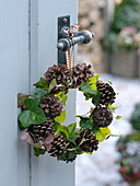 Natural hedera (ivy) and Pinus cones wreath