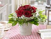 Bouquet of dark red rose, gypsophila