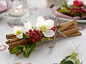 Cinnamon sticks tied together with checkered ribbon