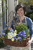 Woman with planted basket, Salix caprea 'Kilmarnock'