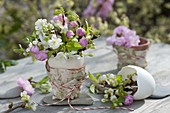 Small Prunus bouquet in duck egg as a vase