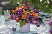 Fragrant bouquet of Syringa, Aquilegia and Geum