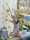 Sticking crushed flowers to easter eggs