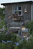 Garden house in the evening lighting with lanterns and lanterns