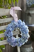 Wreath made of hydrangea hung on chair back