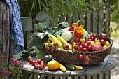 Basket of freshly harvested vegetables