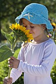 Girl with helianthus annuus (sunflower)