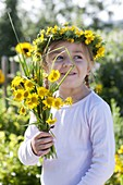 Girl with bouquet and wreath from Anthemis tinctoria