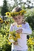 Girl with Anthemis tinctoria bouquet and wreath