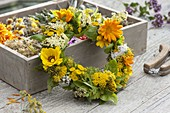 White and yellow wreath of herbs and medicinal herbs