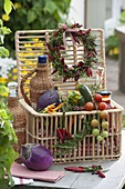Gift basket with vegetables, herbs and preserves
