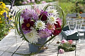 Dahlia bouquet framed by heart of miscanthus