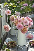 Pink dahlia bouquet in a white jug, wreath of hydrangea