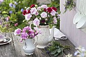 Grandma's coffee pot and milk jug as vases for Dianthus