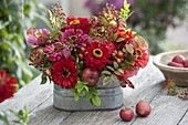 Red late summer bouquet in metal jardiniere