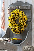 Rudbeckia fulgida (coneflower) wreath on wall shelf