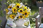 Late summer bouquet with Helianthus, Lathyrus odoratus