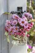 Small bouquet of Aster and fruit stalls of Euonymus