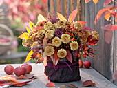Autumn bouquet with chrysanthemum (autumn chrysanthemum), leaves