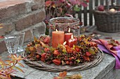 Autumn wreath of physalis (lantern fruit), rose (rosehip)